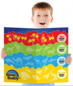 boy holding SleepBuddy rewards chart with stickers